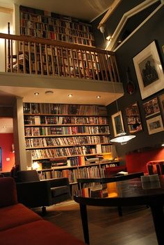 If I had this book wall, I would totally buy all of the books necessary to fill it up.