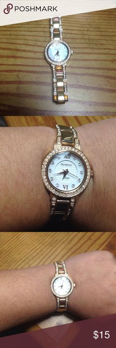 Armitron Rose Gold watch Armitron Rose Gold watch. For someone who has a small wrist (fits a little tight on me)! Has a few scuffs on it but nothing noticeable. Very pretty!  (Not real diamonds) watch still works! Jewelry