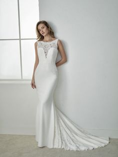 FIDELA Exquisite mermaid wedding dress with an illusion neckline that combines a crepe V-neck with a lace bateau neckline. The open back and skirt play with the two fabrics to add elegance. http://www.sanpatrick.com/ro/wedding-dresses/fidela-illusion-neckline.html  FIDELA