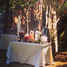 The final product: Boho Bridal Shower / Drink Station / Lace, Yarn and Flower Streamers / Boutique Weddings & Events by Alicia with @meyerhollie