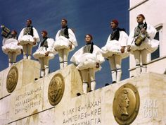 Evzones Stand at Attention on Stairway Wall, a Soldier Blows Trumpet Photographic Print byPhotographer: B. Mykonos, Stairway Walls, Zorba The Greek, Standing At Attention, In Ancient Times, Animal Party, Ancient Greece, Greece Travel, Crete