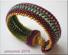 unicorniopasion: Brazalete de crochet- post links to crochet pattern source.  This looks like two Catepillar bracelets with superduos in between and some nice beadwork around the clasp. Intriguing.  #Seed #Bead #Tutorials