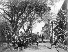 John Soper, commander of provisional government orces, disarms Queen Lili'uokalani's soldiers at 'Iolani Barracks. The monarchy was overthrown on Jan. 17, 1893.