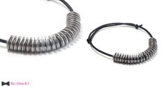 Inox washer necklace with black rope.