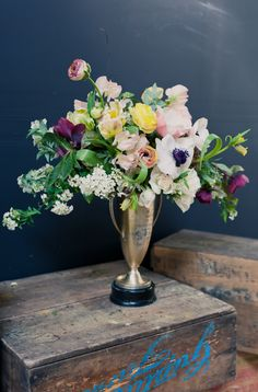 Vintage trophies make great vases and combine the elegance of a silver vase with the quirky touch that vintage displaced objects have.