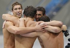 U.S. team members, from left, Matthew Grevers, Nathan Adrian, Michael Phelps and Brendan Hansen celebrate after winning gold in the 4x100m medley relay.