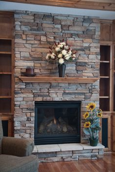 I'd change the mantlepiece style to something more sleek, and change the wood on the sides to something more contemporary - but I love the stone.