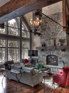 From formal to casual, and modern to classic, these grey living room ideas will satisfy every style of decorator.  #GreyLivingRoom #LivingRoom #DarkLivingRoom Haus Am See, Salons Cosy, Rustic Fireplaces, Stone Fireplaces, Family Room Design, Fireplace Design, Fireplace Ideas, Small Fireplace, Fireplace Mantels