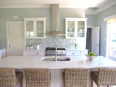 I like how the back splash brings in the natural color of wicker and rush. Coastal Style Kitchens #coastalkitchens #coastalstyle #cottagestyle #coastalcottage thedistinctivecottage.com