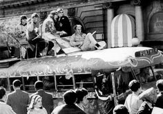 Ken Kesey, on top of the Furthur bus, holding a flute in 1967 during a rollicking trip to San Francisco from his home in La Honda. ~ top down