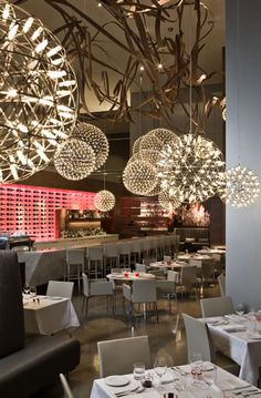 Urszula Tokarska and Stephen R. Pile Architect, made extensive use of the Raimond lamps from Moooi (lamps that look like fireworks) in their design for the Aria Ristorante in Toronto, Canada. Restaurant Design, Deco Restaurant, Restaurant Lighting, Luxury Restaurant, Restaurant Interiors, Living Room Lighting, Home Lighting, Lighting Design, Moooi Lighting
