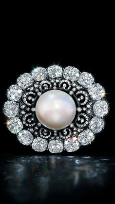 The Putilov pearl and diamond brooch C1900  I'm in awe of those cushion cut diamonds!!! Just incredible!