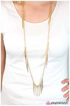Skinny gold bars dangle from the bottom of a simple gold chain creating a stunning icicle design. Additional gold bars climb the sides of the gold chain, infusing the simple design with patches of feathered gold. Features an adjustable clasp closure.  Sold as one individual necklace. Includes one pair of matching earrings.