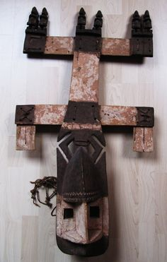 Dogon Kanaga Dancemask. Mali. 94cm. Wood, leather, kaolin. Very rare piece with 6 figures on top. Mid 20th century. Collection PD.