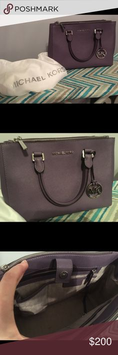 """Micheal Kors Sutton Med Satchel ***Reduced***Micheal Kors Sutton Med Satchel. Wisteria saffiano leather. Silver hardware.Tote handles. Removable, adjustable shoulder strap, 20"""" drop. Snap top framed by two zip pockets. Snap sides. Inside, monogram lining; one zip and four open pockets.9""""H x 12.75""""W x 5""""D.    (Smoke free home. Kept inside dust bag. ) Michael Kors Bags Satchels"""