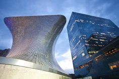The Museo Soumaya and Plaza Carso business complex as night falls.