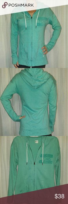 Toms Hoodie Toms zip up hoodie. Teal. Thumb holes. Front pockets. Great condition. TOMS Jackets & Coats