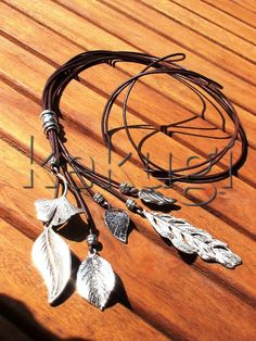 women brown leather necklace with different beautiful silver leaf