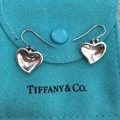 Authentic Tiffany&Co. Silver Carved Heart Earrings Gorgeous 100% Authentic 925 Silver Tiffany & Co. Elsa Peretti Carved Heart drop earrings!! Wonderful condition and includes Tiffany tarnish bag. Will bundle with the Carved Heart Necklace in my closet for 10% off the total of both pieces! No trades please :) Tiffany & Co. Jewelry Earrings