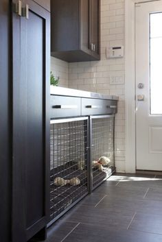 Built-in dog crate area. This is an adorable idea if there is room in the kitchen or mudroom!