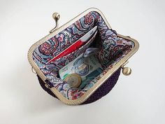 Ultra violet womens wallet handmade crochet from luxury silky yarn and fully lined with Liberty of London cotton fabric, with added pocket for your bank card. Fabric sewed with special care on to bronze tone frame, therefore stitches inside stays unseen! A fun way to wrap up a money gift!