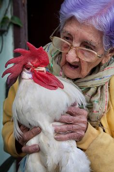 A 95 year old woman with her pet rooster |  Havana, Cuba  | by Jorge Royan Gotta love her hair colour!