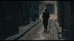 As I saw the stranger walking along the cobblestone street, I figured he must be my contact.