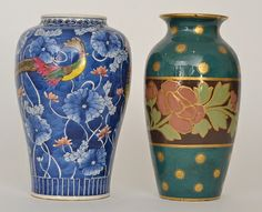 A late 19th Century Wedgwood vase decorated with a central band of pink flowers and foliage against a dark green ground with gold spots, impressed marks, height 23cm together with a 20th Century Japanese vase decorated with exotic birds against a tonal blue floral ground, height 23cm