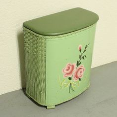 Wicker clothes hamper. The one my family used did not have flowers on it.