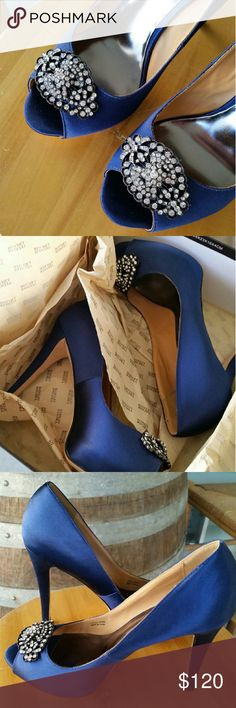 *Badgley Mischka Blue Diamond heels* Gorgeous Badgley Mischka heels, in a dark blue size 7.5! Come with original box, shoe bag, and extra heels. In amazing condition, barely a sign of wear (see pic of bottom of shoe). Not missing any jewels. Make an offer today ? Badgley Mischka Shoes Heels