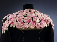 Evening coat circa 1937 made from   Silk jersey, with gold thread and silk embroidery and applied decoration in silk