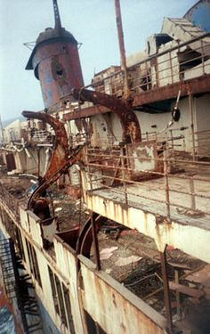 "View of the deck and a ""bazooka"" hole in the smokestack ... American Star formerly SS America. Click on link for more pics aboard wreck"