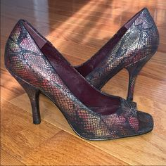 BCBG Open Peep Toe Magenta Snakeskin Pumps Heels BCBGeneration Peep Toe Pumps. Size 7.5 3 inch heel.  Worn once. Excellent condition! They are multi colored / magenta with a snakeskin pattern. Super cute and stylish!  ⭐️Posted on Ⓜ️ercari for cheaper⭐️  NO TRADES PLEASE. Thank you for your interest :) xox BCBGeneration Shoes Heels