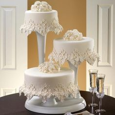 The lace-like work around bottom of each cake is beautifully done, unique design to enhance any Cake Cutting Ceremony.