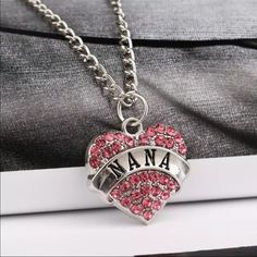 Nana Necklace Pretty silver toned zinc alloy necklace. This has pink rhinestones. Chain is about 24 inches plus an additional 2 inch extender. New in package. Jewelry Necklaces