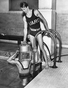 """Feb. 24, 1934: """"Perfect New Diving Helmet!"""" After a year of experimentation, Eric D. Chapman of Cleveland, right, developed this 95-pound diving bell, which allowed its wearer to """"descend in depths of 50 feet of water and move about without difficulty or discomfort."""" He hoped to deploy the device at the summer Y.M.C.A. camp he directed, """"so that hundreds of small boys will be able to view strange sights at the bottom of their small island lake."""""""