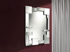 ESPEJO DREAMS 385213 SCHULLER   • Espejo decorativo rectangular.  • Espejo con marco formado por lunas biseladas de distintos tamaños, colocadas asimétricamente y con diferentes ángulos de inclinación.   • Trasera de madera color negro.  • Medidas: 64 x 90  Fondo:  6 cm.  • Preparado para colgar en posición horizontal o vertical.