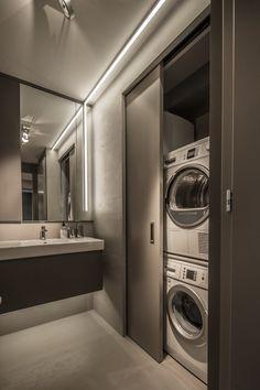 Társasházi 40nm-es, modern kis lakás praktikus térszervezéssel, a szürke árnyalataival