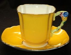 Royal Stafford, mustard yellow, flower handle, tea cup and saucer Teapots And Cups, Teacups, Cup And Saucer Set, Tea Cup Saucer, Vintage China, Vintage Tea, Mellow Yellow, Mustard Yellow, Yellow Tea Cups