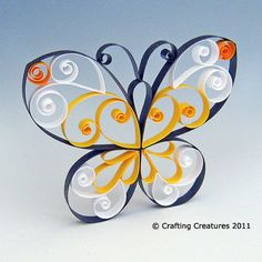 Quilling papillon – tutoriel PDF de motifs Learn to feather butterflies as exquisitely as the original. Ideal for decorating greeting … Quilling Butterfly, Arte Quilling, Quilling Letters, Quilling Paper Craft, Butterfly Crafts, Quilling Designs, Paper Crafting, Quilled Roses, Quilling Jewelry