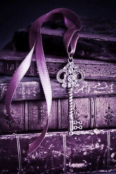 Purple Vintage Books with a Key Bookmarker                                                                                                                                                      More