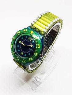 LOT SWATCH S1-1 1. Case diameter: 40 mm 2. Case thickness: 10 mm 3. Lug width: 17 mm 4. Lug to lug: 43 mm Green Swatch Watch for men, Swatch watches for men, Ladies watch for ladies, Watch women watches, womens watch, steampunk watch, mens watch 1990, Swatch Watch Fall Rolex Watches, Watches For Men, Steampunk Watch, Watch Women, Antique Items, Winter Collection, Casio Watch, Happy Shopping, Swatch