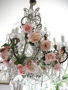Romantic lighting; add pink roses to wedding reception crystal chandelier for vintage style decoration; upcycle, recycle, salvage, diy, repurpose!  For ideas and goods shop at Estate ReSale & ReDesign, Bonita Springs, FL