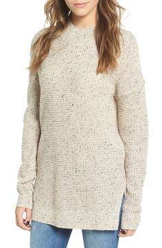 A split high/low hem makes this cozy knit sweater perfect for layering over figure-hugging pieces.