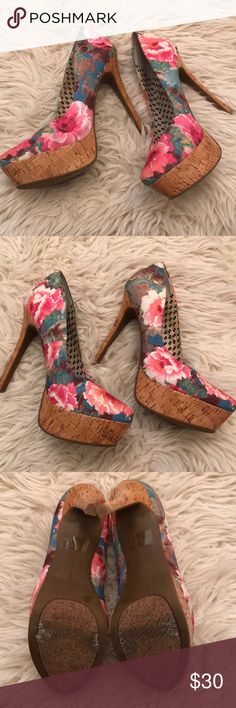 Floral & Cork Platform Heels Love these! Fun for spring and summer. My feet grew post baby so they don't fit anymore. Great condition! Jessica Simpson Shoes Heels