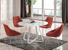 """Vera Modern 5 Pcs Dining Set SKU18227 Description : J&M Is proud to introduce the Vera modern dining collection. This dining collection features an optic white glass top paired with uniquely shaped white metal legs for a luxorious look. The table is contrasted by modern chairs which are upholstered in a pumpkin fabric for bold contrast Features: Vera Modern Dining Collection White Glass Top Metal Legs Include Dining Table And 4 Chair Free Shipping  Dimensions : Table:47.2""""D x 29.5""""H…"""