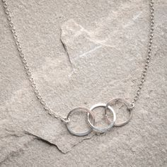 """Freshie and Zero """"Cartwheel"""" Necklace- Remember turning cartwheels on the school playground? Turn cartwheels of excitement again with this Cartwheels necklace by Freshie and Zero. Three hoops hooked together mimic the motion of cartwheels adding vitality to your style."""