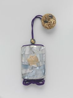 Case (Inrô) with Design of the Silk Winder and the Milky Way (The Tanabata Story of the Weaver and the Herdboy)  Kyûkoku   Period: Edo period (1615–1868) Date: 19th century Culture: Japan Medium: Mother-of-pearl with gold; Ojime: silver and gold quail in autumn grasses; Netsuke: carved ivory flowers and grasses with silver butterflies