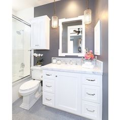 The #1 question we get asked on Houzz is for the color of this bathroom! The paint color is Restoration Hardware in 'Charcoal'