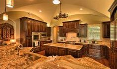 Large gourmet style kitchen complete with thermador appliances, granite countertops, pendant lighting and dramatic groin vault.